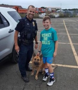 Officer Disch, K9 Jagger, and Liam